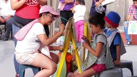 Children painting in a paint and draw activity. Tepotzotlan, Mexico-CIRCA June 2017: Children painting in a paint and draw activity. Mexico is widely known by stock video