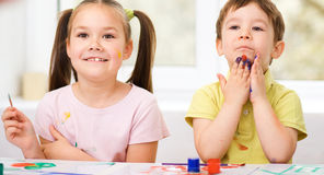 Children are painting with paint Royalty Free Stock Images