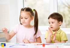 Children are painting with paint Royalty Free Stock Photography