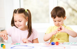 Children are painting with paint Stock Image