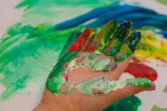 Children painting with pinger paint. Oon white paper Stock Photos