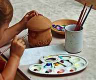 Children painting pottery 1 royalty free stock photography