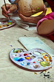 Children painting pottery 7 royalty free stock photo