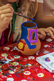 Children painting pottery 12 Royalty Free Stock Photo