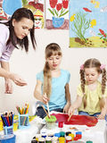 Children painting in preschool. Royalty Free Stock Photos