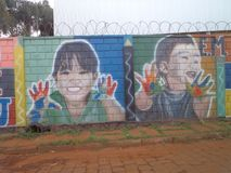 Children, painting on school wall royalty free stock photography