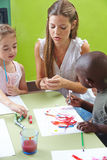 Children painting with tempera Stock Photos