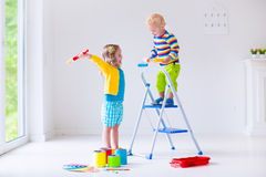 Children Painting Walls At Home Stock Photography