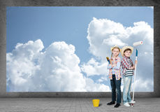 Children paints the wall Royalty Free Stock Photo