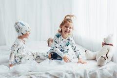 Children in pajamas Stock Images
