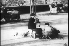 Children palying in Central Park, New York City, 1930s stock video