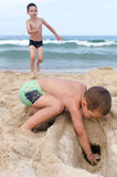 Children palying in sand on a beach Royalty Free Stock Photography