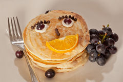 Children Pancakes. Top View of Children Pancakes with fruits and choco chips Royalty Free Stock Photography
