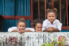 Children of Papua. Jayapura, West Papua, Indonesia - circa February 2016: three schoolgirls posing for the camera royalty free stock image