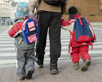 Children a parent crossing road Stock Photo