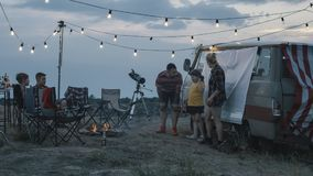 People with children playing charades in campsite royalty free stock photos
