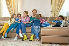Children and parents. Smiling people indoor. Facts about American families Stock Image
