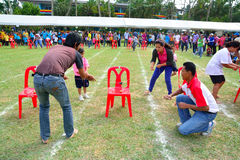 Children and parents doing a teamwork racing at Kindergarten sport day Stock Photo