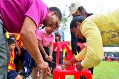 Children and parents doing a teamwork racing at Kindergarten sport day Royalty Free Stock Photos