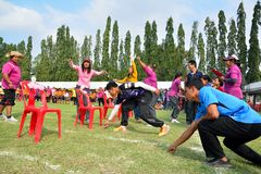 Children and parents doing a teamwork racing at Kindergarten sport day Royalty Free Stock Photo