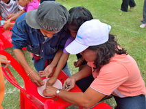 Children and parents doing a teamwork racing at Kindergarten sport day Stock Photography