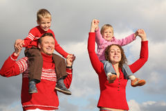 Children on parents shoulders royalty free stock photo