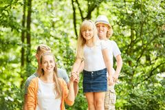 Children and parents together in the countryside royalty free stock photo