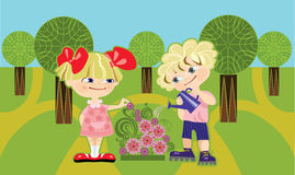 Children in park. Children pour water from a watering-can on flowers Royalty Free Stock Photo