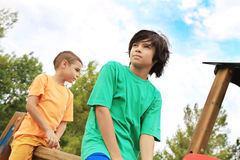 Children in the park. Children having fun in the park Stock Photos