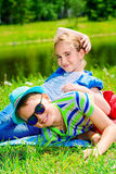 Children in a park. Two children friends spending time together in the park on a sunny day. Summer holidays. Friendship royalty free stock photography