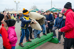Children participate in comic fights on pillows during Shrovetide entertainment royalty free stock photography