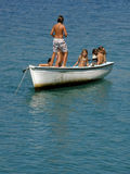 Children party on sail boat. Boy and girlsChildren (best friends) on school vacation, enjoy, swimming, sunbathing, on a small white board at Adriatic sea Stock Photography