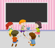 Children passing gift box to each other Royalty Free Stock Photography