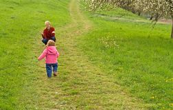 Children on the path. Child on the path in the grassland in springtime stock photo