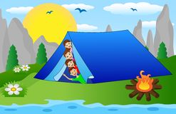 Children peek out from a tourist tent on the riverside Royalty Free Stock Images
