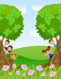 Children peek out from trees Stock Photos