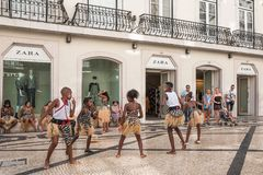 Children perform african dance on Augusta street, Lisbon. Lisbon, Portugal - August 23, 2017 Street performance in busy historic center Baixa District Stock Photos