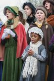 Children perform in a musical during the Dickens Festival. Deventer, Netherlands – December 18, 2016: Children perform in a musical during the Dickens Festival Royalty Free Stock Photo
