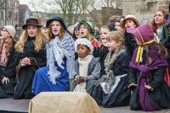 Children perform in a musical during the Dickens Festival. Deventer, Netherlands – December 18, 2016: Children perform in a musical during the Dickens Festival Royalty Free Stock Photography