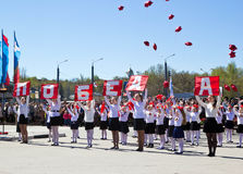 Children perform at Victory Parade stock image