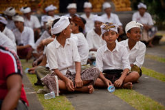 Children during performed Melasti Ritual on Bali Royalty Free Stock Images