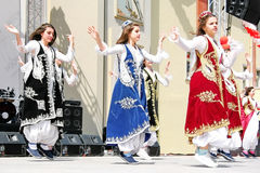 Children performing folk dance Stock Images
