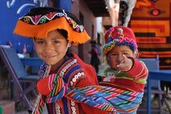 Children from Peru. August 2010, Pisaq (Peru) - Two children at the market stock photography