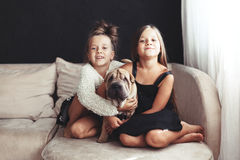Children with pet Royalty Free Stock Photo