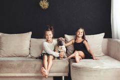 Children with pet Stock Photography