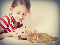 Children and pets. In retro style Stock Photos