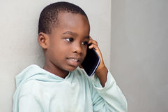 Children on the phone. This child on the phone, listening intently his interlocutor Stock Photo