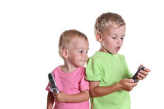 Children with phones stock image