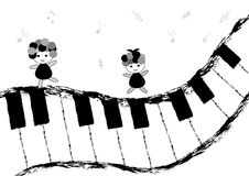 Children and piano keyboard. Children dancing and singing on piano keyboard Stock Photo