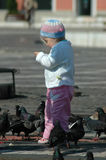Children and pigeons. Portret in my city Royalty Free Stock Photos